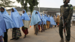 Girls who were kidnapped from a boarding school in the northwest Nigerian state of Zamfara walk in line after their release Afolabi Sotunde/Reuters