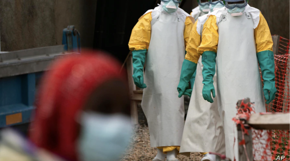 Health workers dressed in protective gear